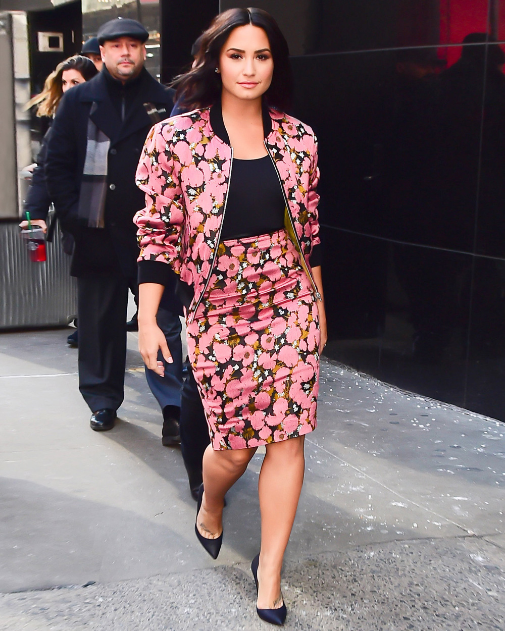 Demi Lovato In Floral Bomber Jacket Matching Pencil Skirt And Prada Pumps About Her