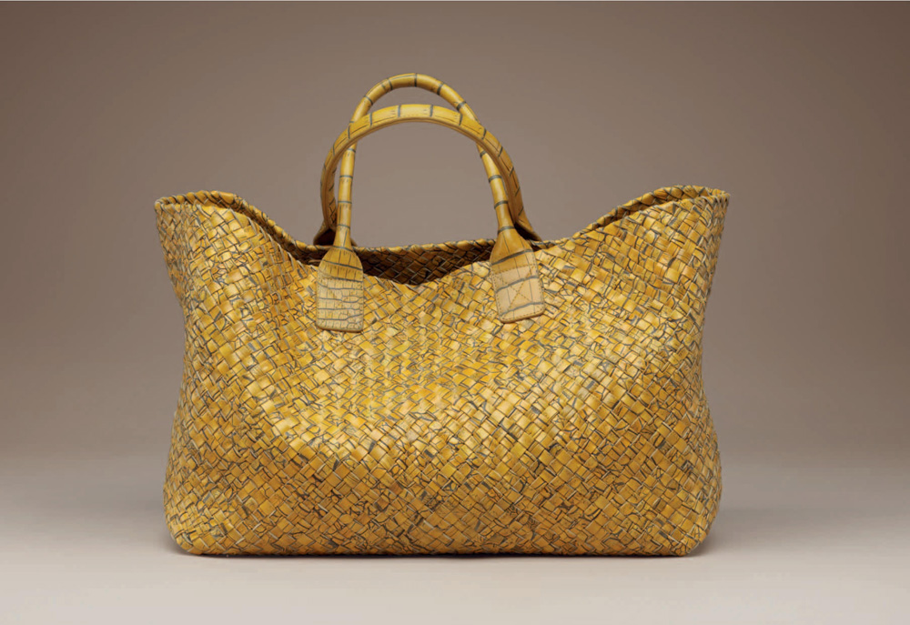 The bag s perfect shape and clear function have proved an irresistible  canvas for Maier and the Bottega Veneta artisans. It s even inspired other  styles ... 26ace78ad1a15